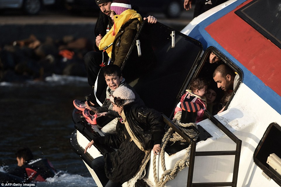 Sorrow: One young boy screams and cries in terror as the boat wildly rocks in the strong currents off the coast of Lesbos