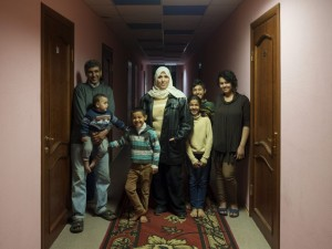 A family of Syrian refugees at the Polar Light Hotel in Nikel, Russia. October 2015. (Alessandro Iovino)