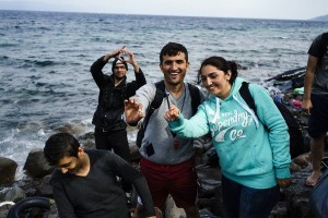 Mahmud, 28 and his bride Firal, 25, from the Syrian city of Kobane show their rings, as they arrive with other refugees and migrants on the Greek island of Lesbos, after crossing the Aegean sea from Turkey on October 8, 2015. Europe is grappling with its biggest migration challenge since World War II, with the main surge coming from civil war-torn Syria. Greek premier Alexis Tsipras said on October 6, 2015 that Athens would upgrade its refugee facilities by November to tackle the growing influx from Syria as the EU pledged 600 extra staff to help. AFP PHOTO / DIMITAR DILKOFF        (Photo credit should read DIMITAR DILKOFF/AFP/Getty Images)