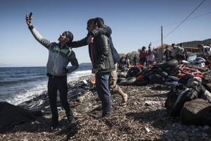 Refugees from Afghanistan and Syria take selfies after arriving in boats on the shores of Lesbos on November 2, 2015 near Molyvos, Greece. Lesbos, the Greek vacation island in the Aegean Sea between Turkey and Greece, faces massive refugee flows from the Middle East countries. (Photo by Etienne De Malglaive/Getty Images)