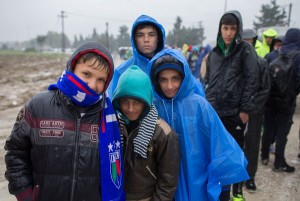 Migrants, who have just arrived by bus, queue in the rain at a refugee transit camp that has been set up on the border of Greece with the Former Yugoslav Republic of Macedonia on October 22, 2015 in Idomeni, Greece. Despite the worsening weather, thousands of migrants have continued to arrive at the small border village as they persist in their journey on towards Western Europe.  (Photo by Matt Cardy/Getty Images)