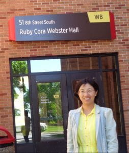 Dr. Chen in front of Ruby Cora Webster Hall