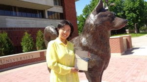 Dr. Chen in front of SCSU husky