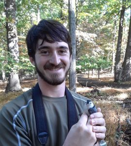 Kevin with a White-breasted Nuthatch
