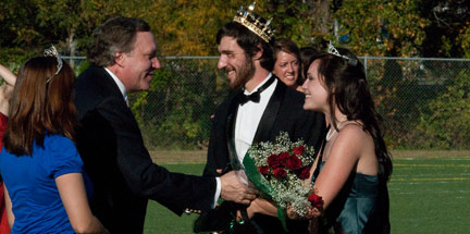 Dr. Parrott awards Madison Childs with flowers as the 2009 Homecoming Queen and congratulates Alex Freel as Homecoming King.