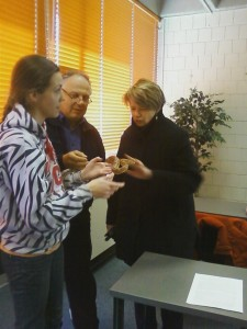 Ellen Kennedy and Bob Deluca get to hold a snake.