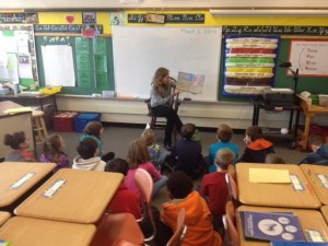 "Mary Parkman, Service-Learning Coordinator, reading ""The Lorax"" by Dr. Seuss to a 4th grade class."