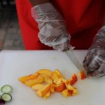 food service hands cutting peaches CCE Widen