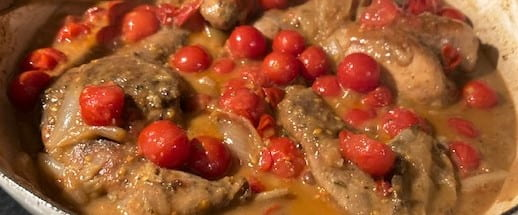 grouse with shallots and cherry tomatoes in pan