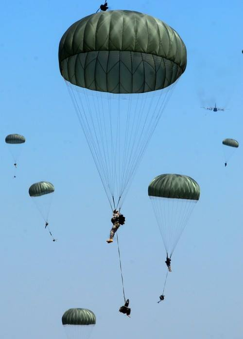 Soldiers of airborne school make a combat equipment drop above Fryar DZ in Alabama,