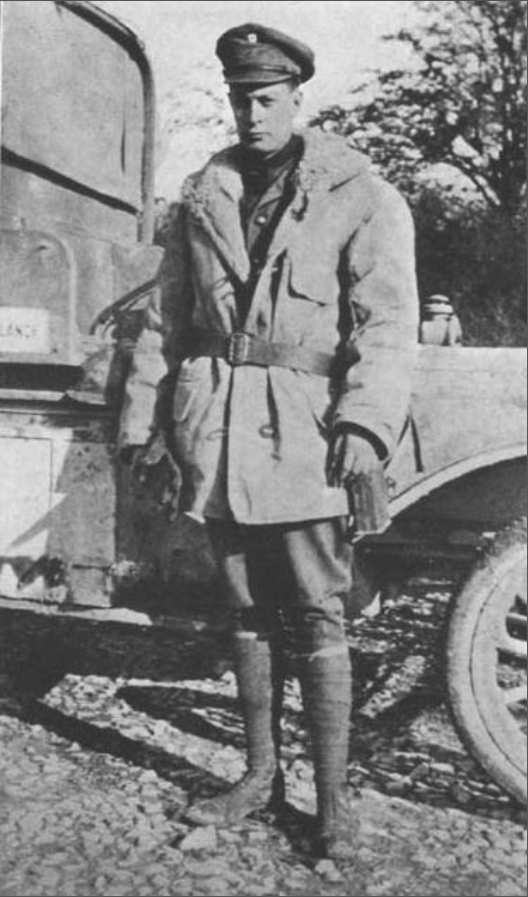 Cornellian Edward Isley Tinkham led the first American Unit into combat in WWI. here he stands alongside one of his ambulances in Europe.