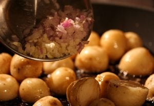 adding-garlic-and-onion-to-potatoes
