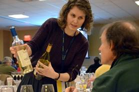 Erin Norton of Iowa State University pours La Crescent during the cold hardy white wines tasting session. Photo: Lani McKinney