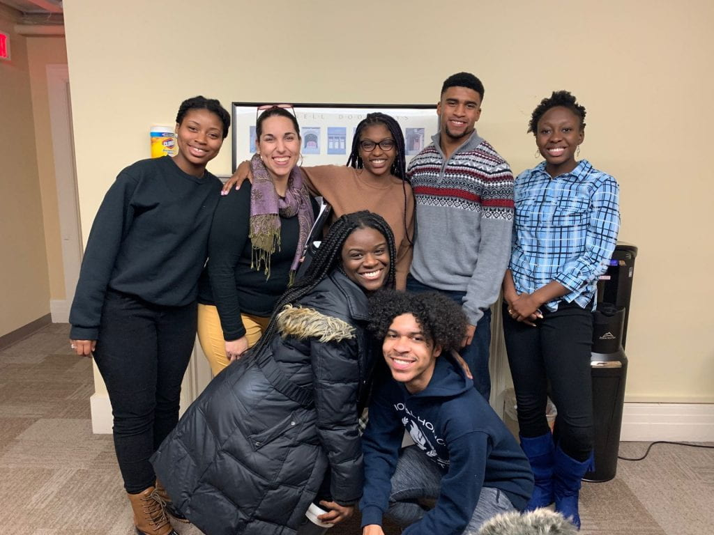 Diversity Outreach interns and ambassadors take part in a fall text event while Associate Director of Admissions Alyssa Orrantia supervises.