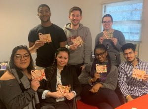 Diversity Outreach Interns pose together at a holiday gathering.