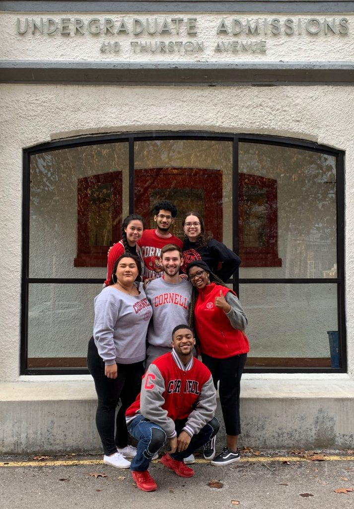 Student Interns pose before the admissions building.
