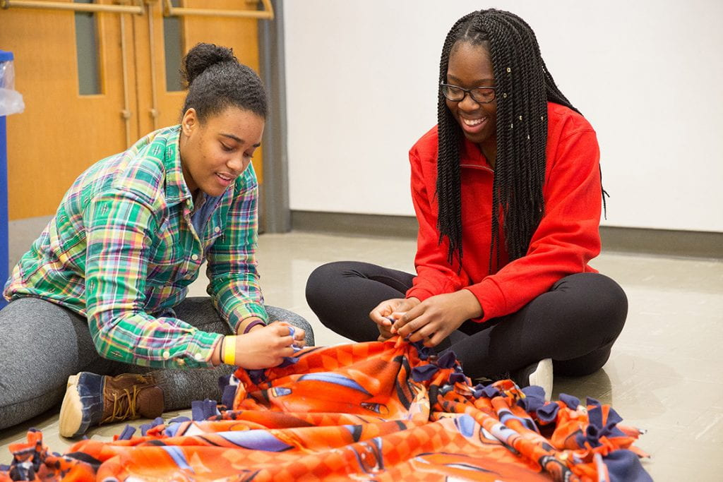 Students make fleece blankets at the 2016 Cornell Tradition (TRAD) Season of Service Celebration.