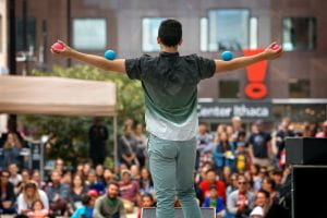 A student juggles at the 2017 CU Downtown event on Ithaca Commons.