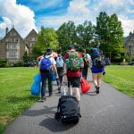 Students pull their luggage across North Campus