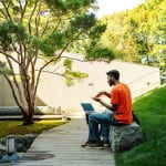 A student practices sign language outside the Johnson Museum of Art.