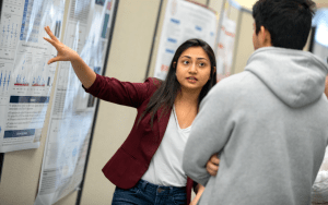 A student shows her research