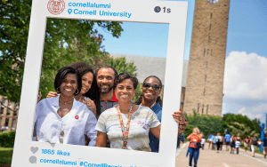 Cornell Alumni posing in front of McGraw tower during a reunion