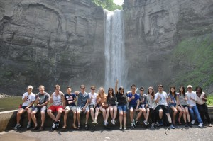 Students pose for a photo in front of Taughannock Falls.