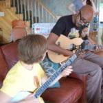 Yasir Ahmed & Amanda Manfredo playing bango and guitar at the 2016 retreat