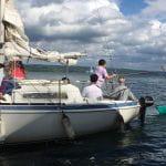 Members on sailboat