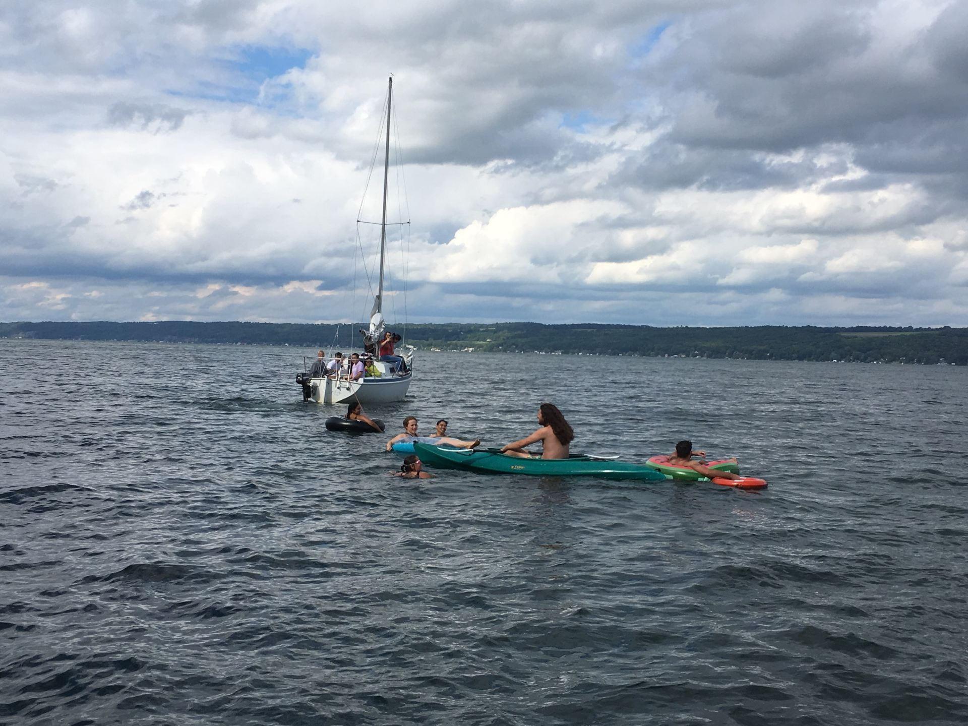 Lab members in Cayuga lake creating a flotilla