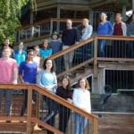 Clark lab members on deck of retreat house, Fall 2018