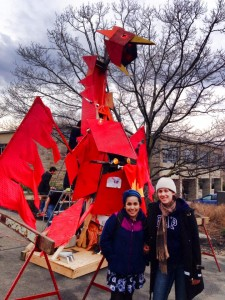 Students pose by the Phoenix as it awaits the coming of the Dragon