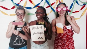 "(L to R) Sarah Gaylord '18, Alyssa Elezye '17, and I pose with homemade props during our ""Harry Potter"" party on July 31st."