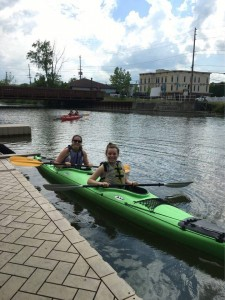 Sarah Gaylord '18 and I pose in our kayak before paddling out to Cayuga Lake.