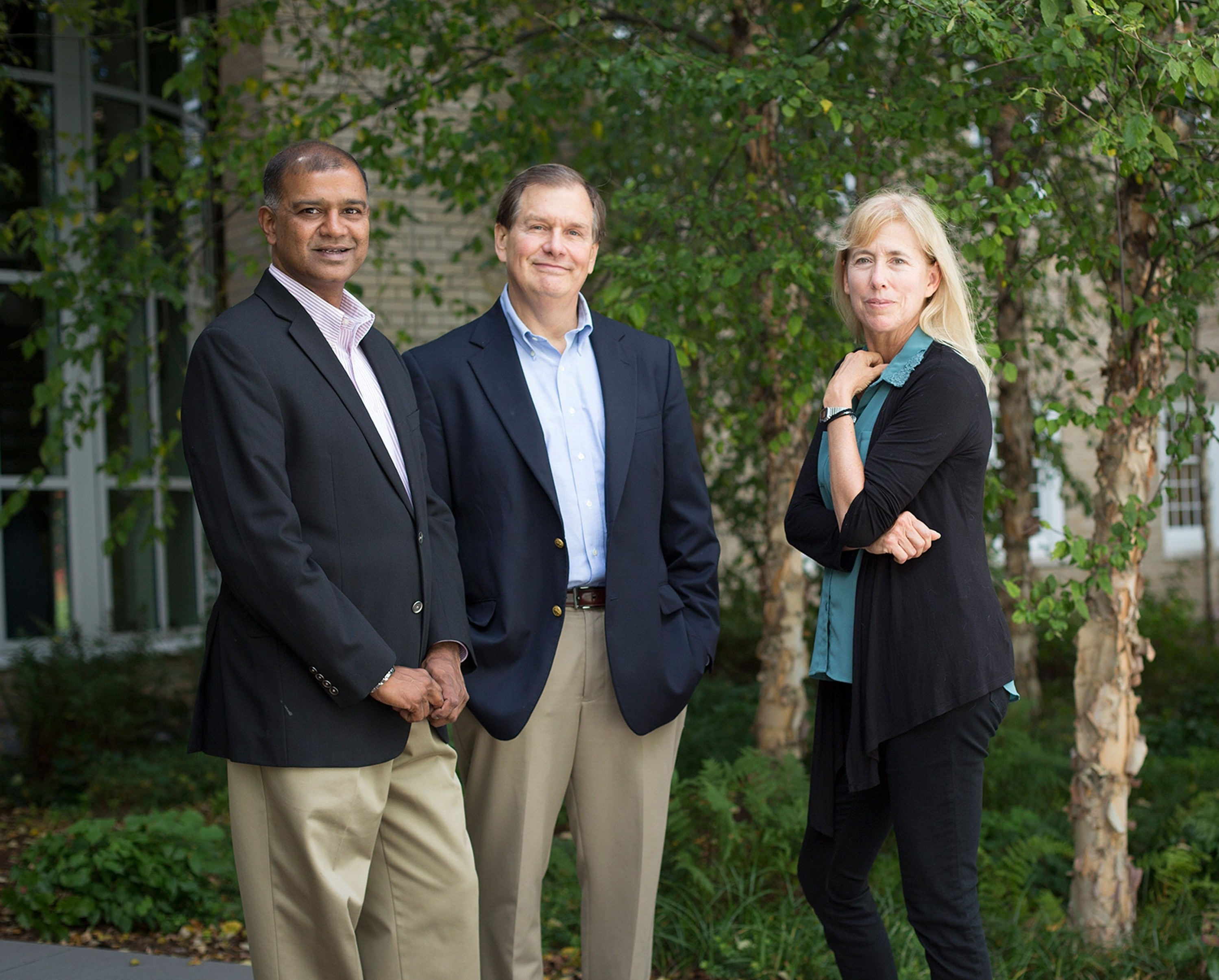 Photo of Rohit Verma, Brooke Hollis, and Mardelle Shepley standing outside in an area with trees and grass