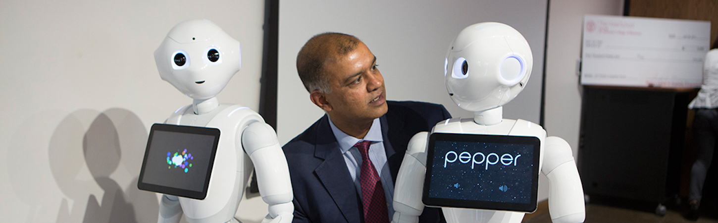 Photo of Rohit Verma interacting with robots
