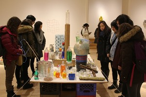 Students observe Tony Feher's work at the Bronx Museum
