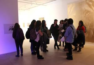 Jane Benson guides students through Michael Fullteron's show at Greene Naftali gallery.