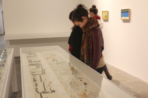 Second year BFA, Melody Stein looks at some of the works on paper displayed in the show. Photo by Danni Shen.