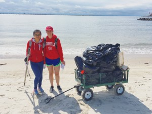 Two Cornell students, Sophia Robison (MRP, 2017) and Xiaoying Li (MLA, 2018) show off their trash pile at the end of the NYC H2O Plumb Beach Cleanup Day.