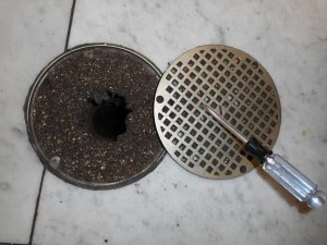 Water cannot penetrate drain grates clogged with dirt and debris. This drain should be cleaned (drain brush or shop vacuum) and flushed with water.