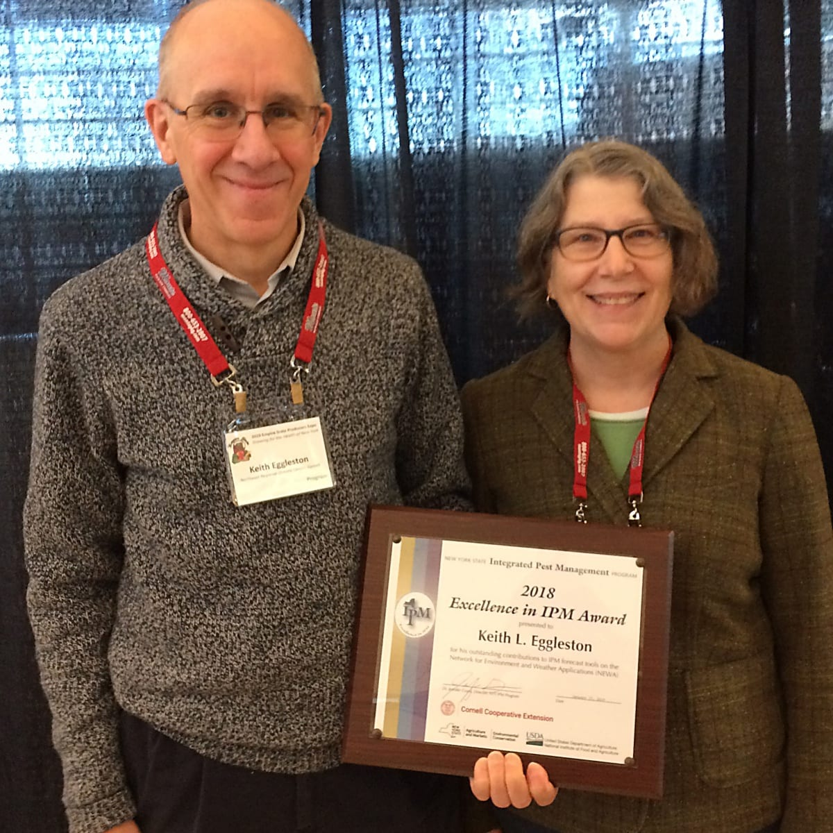 Photo shows Excellence in IPM Award winner Keith L. Eggleston and NYSIPM Fruit IPM Coordinator, Dr. Juliet Carrol