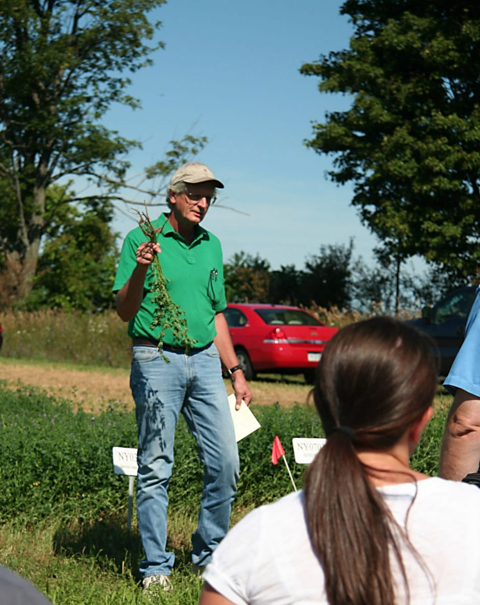 Dr. Shields is seen in this photo as he speaks with a group of growers.