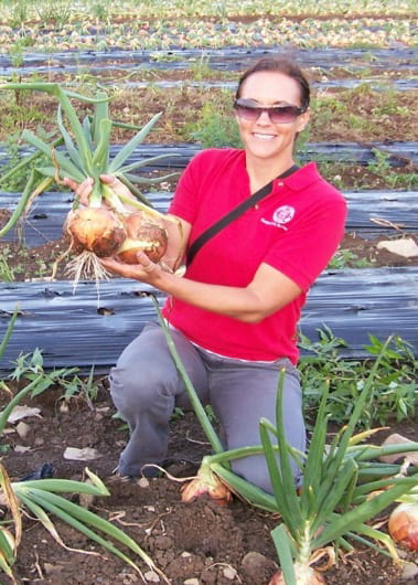 Photo shows Christy Hoepting in an onion field.