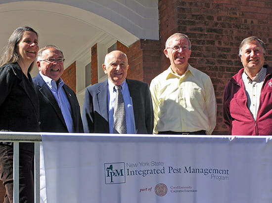 photo of five past and present IPM directors on porch of IPM house