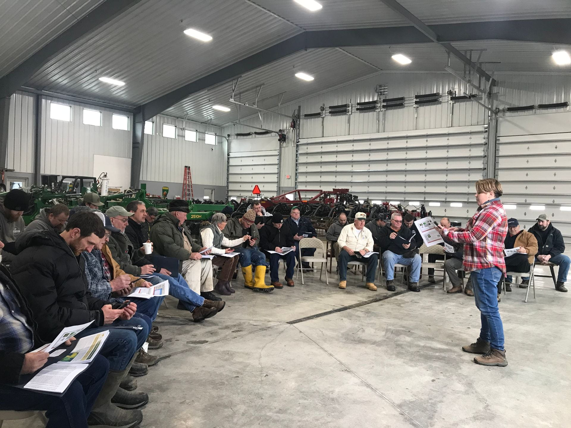 Photo shows New York State Integrated Pest Management Program's Jaime Cummings speaks to a group of soybean farmers about soybean diseases.