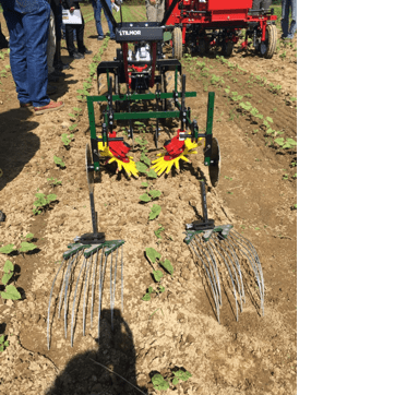 image shows a pull behind cultivator with mutlple soil disturbance adaptions