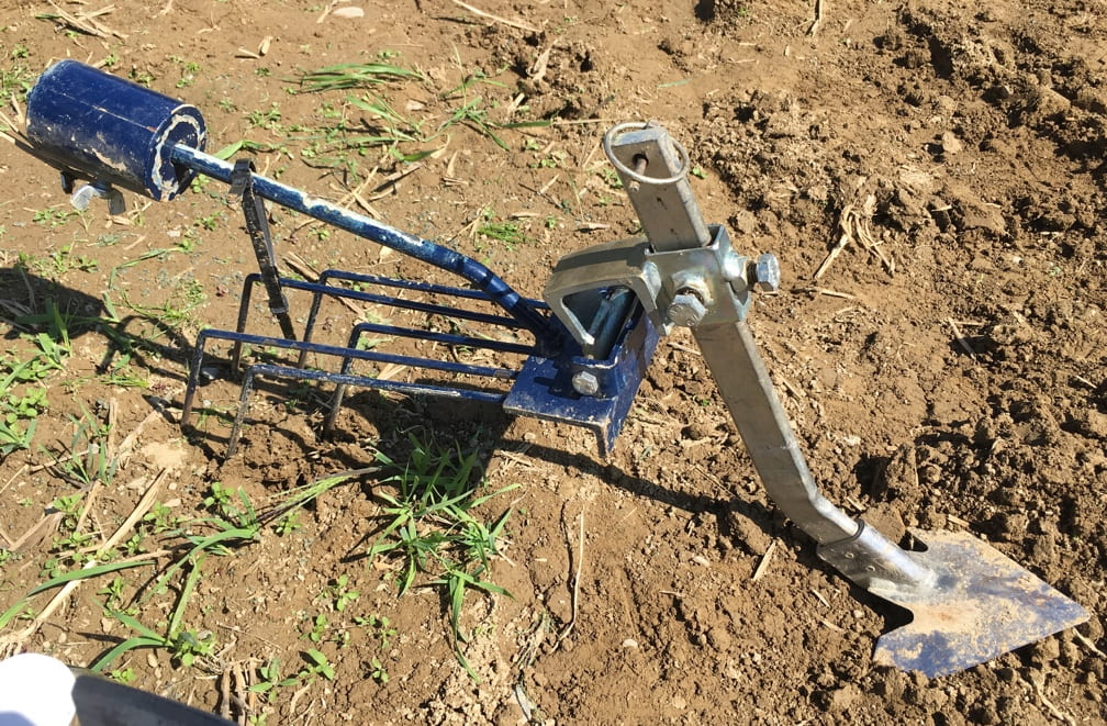 image shows a small attachment suitable for weeding grain fields.