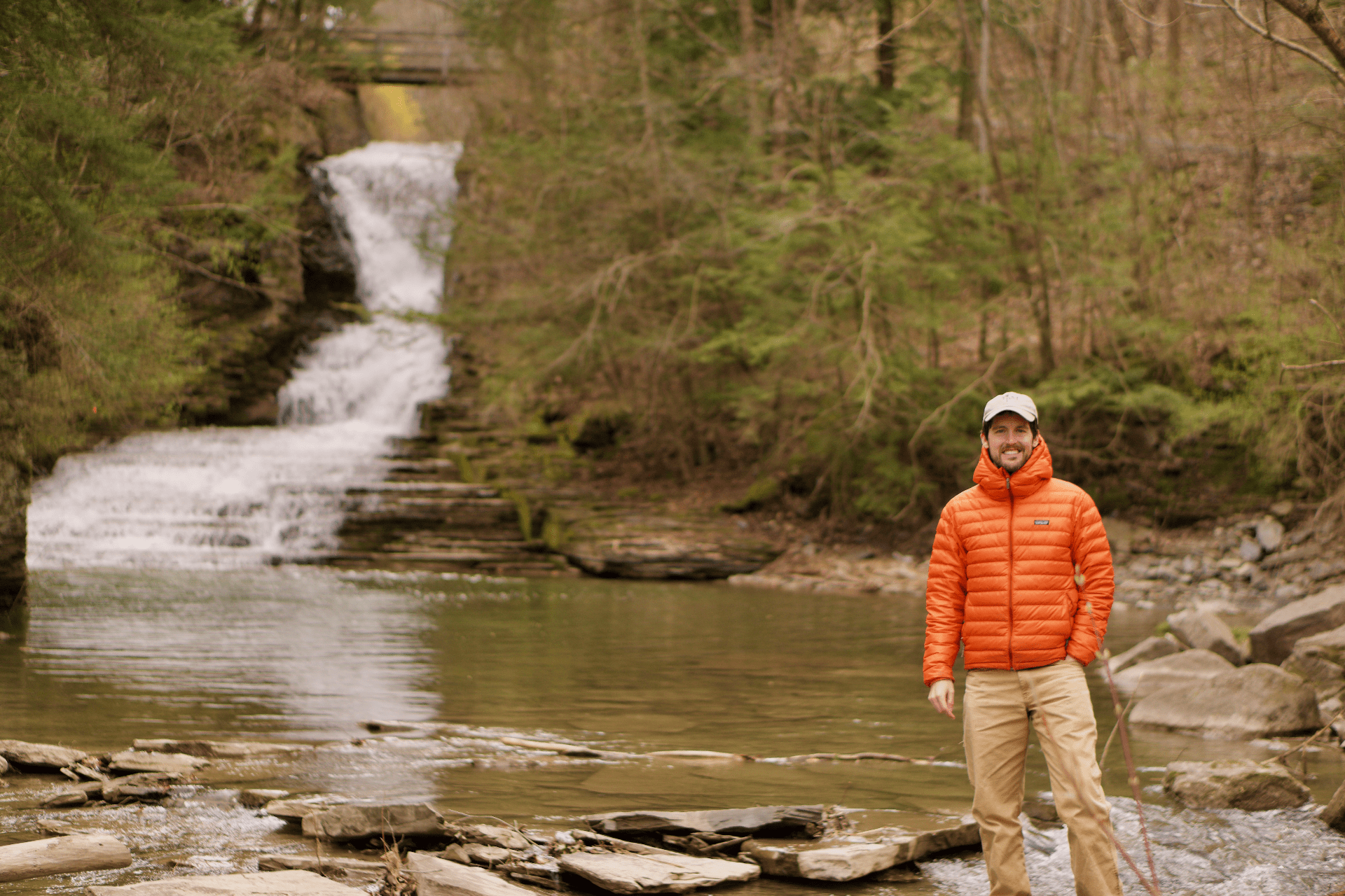 photo of Bryan Brown standing near a small waterfall in upstate new york