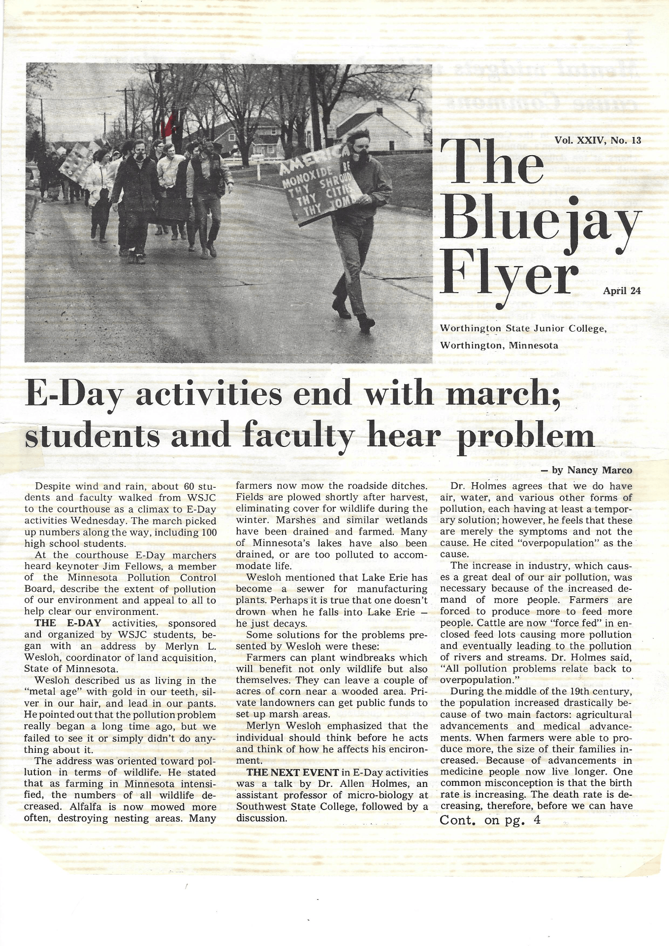 scanned newspaper article about a march on a college campus